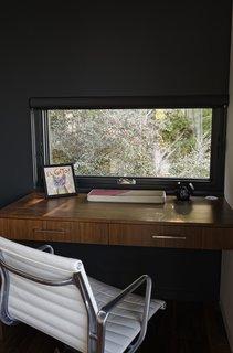Chris designed a custom built-in desk in the den for Ellen, who often works from home.
