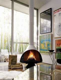 The Malm Fireplace via DWR is available in black, white, or stainless-steel.
