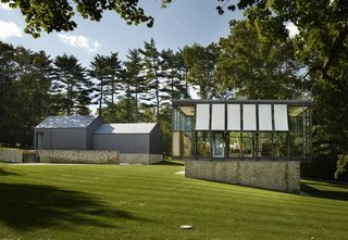 12 Modern Marvels in New England - Photo 10 of 12 - Johnson built the Wiley House at a time when the midcentury movement was booming, especially in New Canaan. While more and more architects were beginning to build minimal structures that fit into the surrounding nature, his second glass pavilion-style house was born. Unlike the Glass House, which has become a cherished relic, this home has endured through multiple life stages and has had to adapt over time.