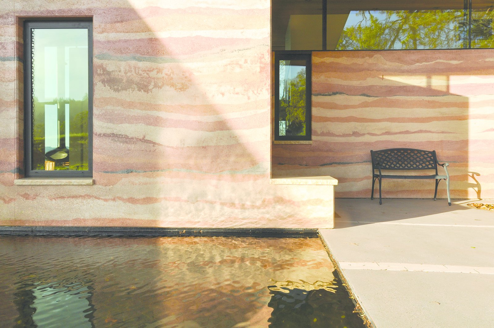 Outdoor, Back Yard, Front Yard, Side Yard, and Standard Construction Pools, Tubs, Shower A 70-square-foot reflecting pool greets visitors as they approach the home's elemental north entrance.  Photo 5 of 8 in Geological Formation
