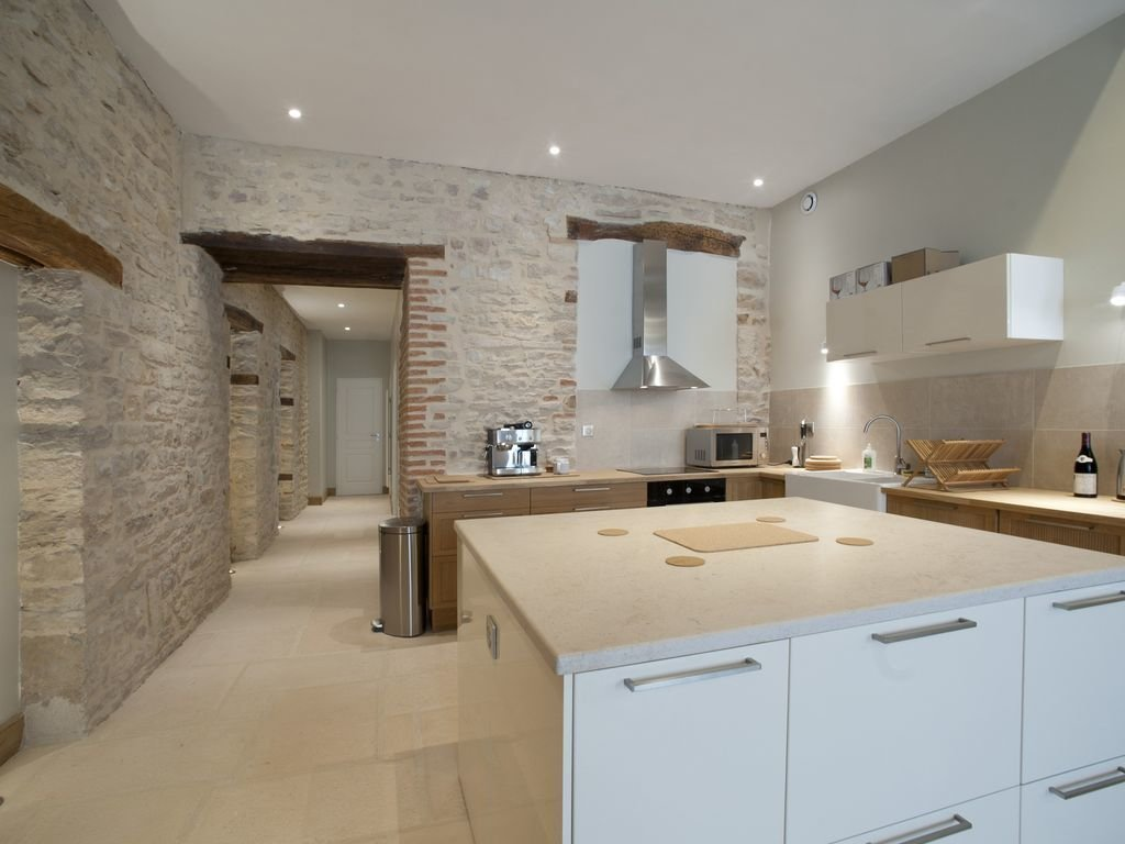 Kitchen, Wall Oven, Drop In Sink, Wood Cabinet, White Cabinet, Microwave, Cooktops, Range Hood, and Recessed Lighting Apartment located in the heart of the historical center of Beaune.  Photo 3 of 11 in 10 Rentable Homes in the World's Best Wine Regions