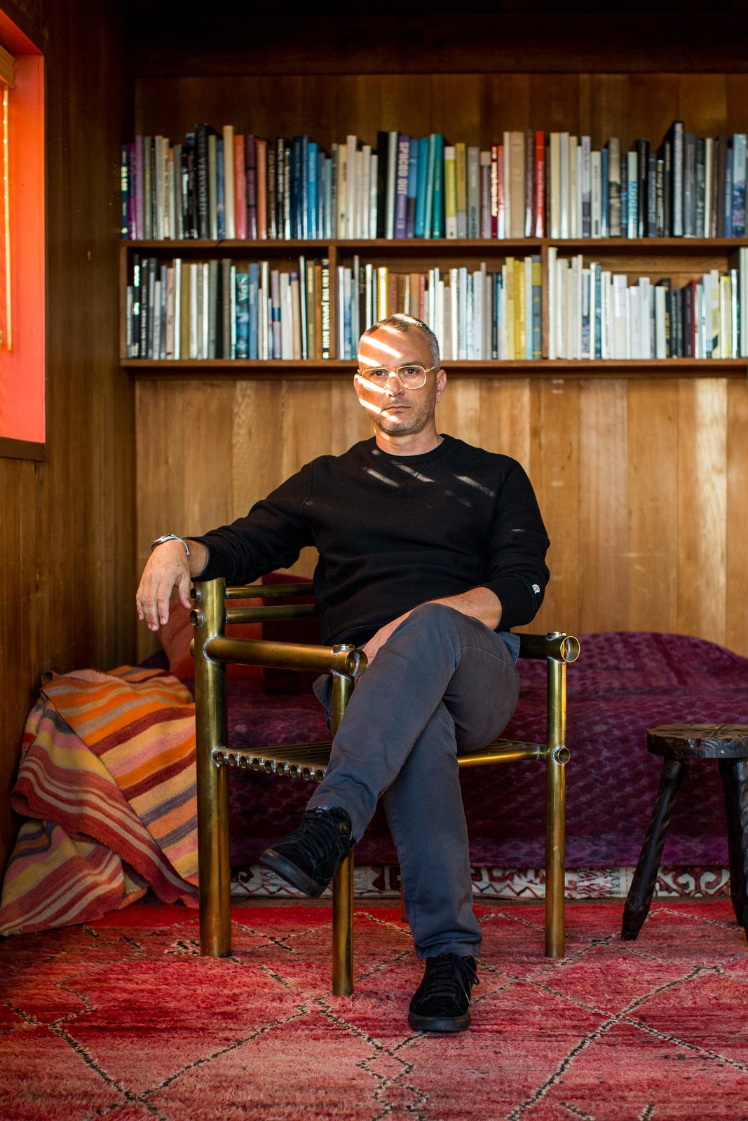 Charles de Lisle is shown here sitting in his Marin, California home. As a designer of furniture, lighting and objects, de Lisle mixes unexpected materials and mediums to create useful objects that are full of texture and character.  Photo 1 of 12 in Creatives of the Bay Area Series: Charles de Lisle