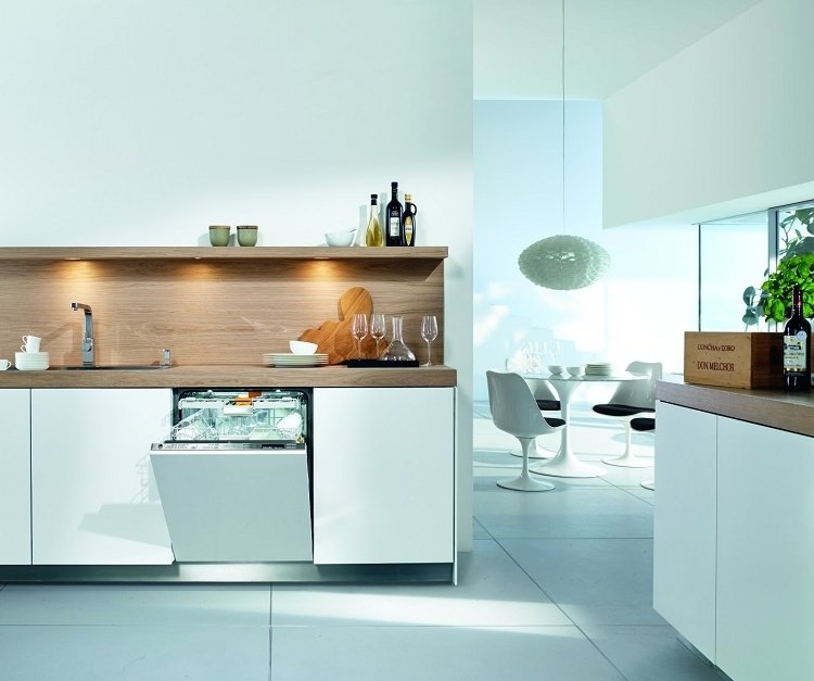 This white Miele model is designed to blend seamlessly into white kitchen cabinetry. The brand's patented Knock2Open technology does away with handles, allowing for a completely flush façade that users tap twice to gain access. It comes equipped with an adjustable cutlery tray and interior LED lights, and it automatically recognizes how full the load is and adjusts energy and water use accordingly. It is also one of the quietest dishwashers available at 38 decibels.  Photo 3 of 6 in 5 Modern Dishwashers