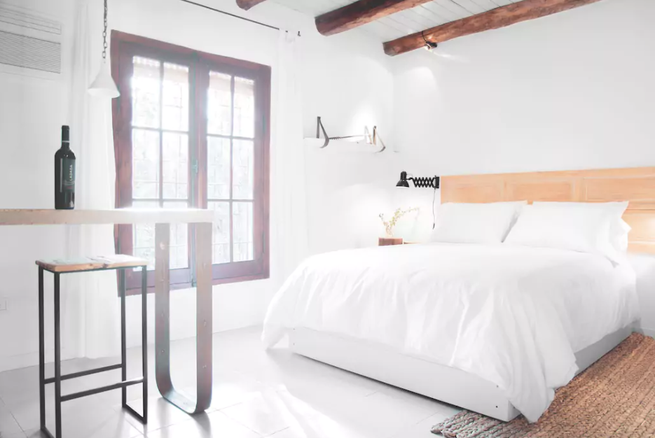 Bedroom and Bed This bright, rustic and clean room with well laid Southeast orientation is situated in a quiet street. It has a bedroom, bathroom and living room to enjoy a good glass of wine.  Photo 10 of 11 in 10 Rentable Homes in the World's Best Wine Regions