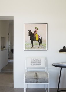 The Pee-wee Herman print that inspired the casita's color palette hangs above a chair from Hill's Pulpoetry series.