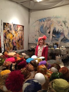 Shown here is a visitor in Fitzpatrick's art studio, where they house their collection of vintage feather hats from the mid-1950s to the 1970s—many of which are vintage Dior.