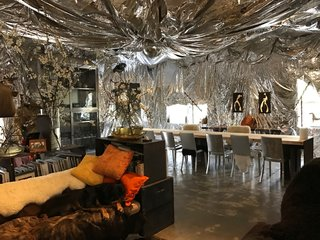 After seeing a mylar installation by a friend of theirs, they decided to drape their dining room with the bold material.