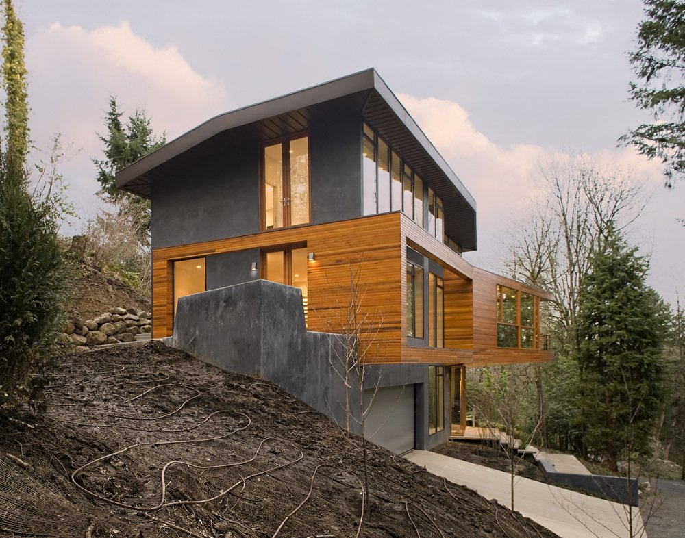 Exterior, House Building Type, Concrete Siding Material, and Wood Siding Material Skylab Architecture cantilevered the living volumes in order to minimize the building's footprint and to create a tree house-like experience for the residents.  Photo 5 of 16 in 10 Modern Homes That Made a Star Appearance in Films
