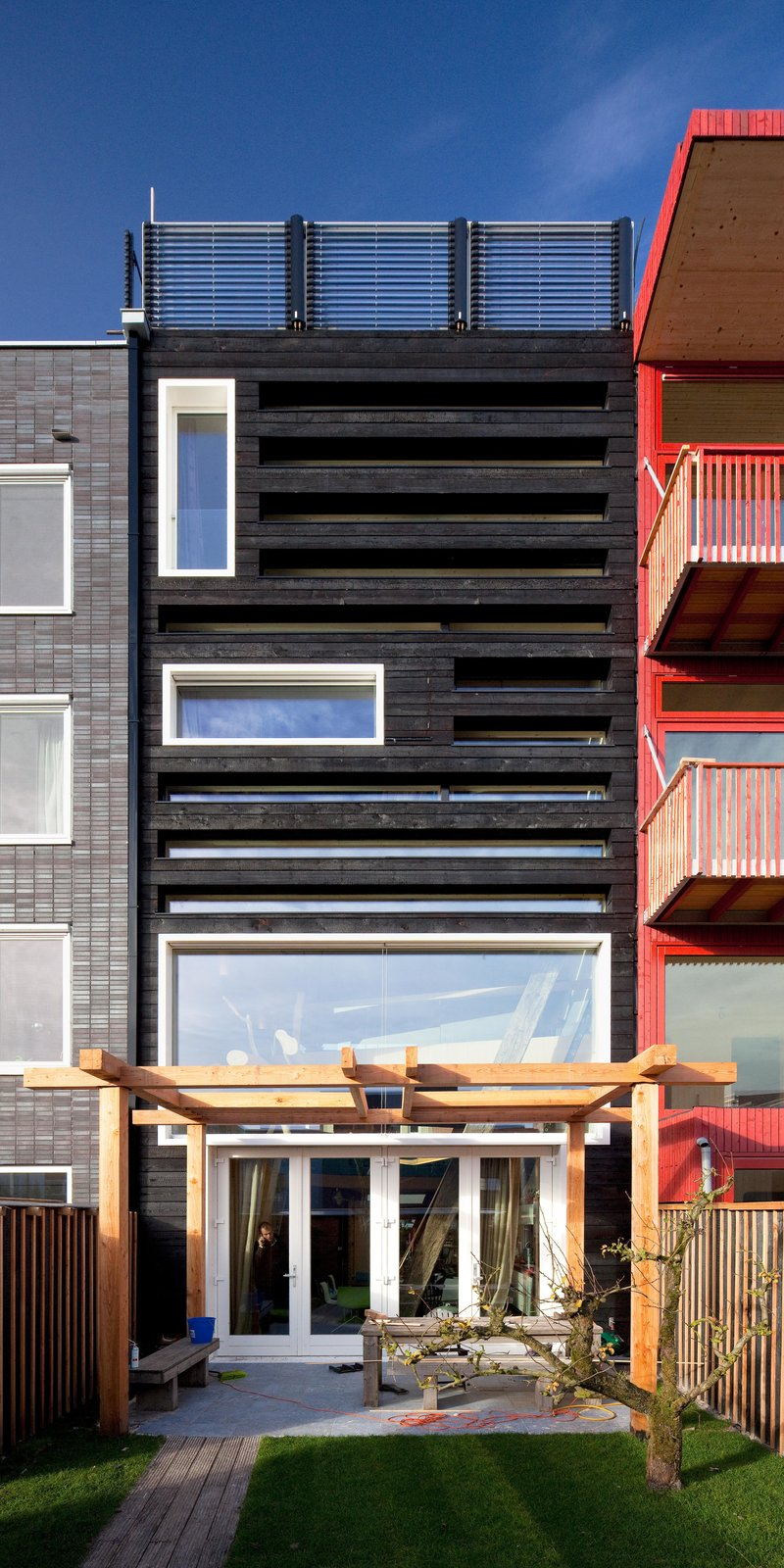 A pergola is located at the rear of the house. This structure provides shade in the summer and lets sun into the house during the winter.  Photo 1 of 5 in A Passive House in the Netherlands Embodies 5 Tips to Consider When Planning Your Own