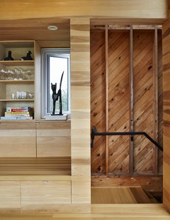 """Stairwells and service areas utilize knotted planks. """"It's akin to stepping offstage into the wings,"""" resident Rhonda Rubinstein says of the transition."""