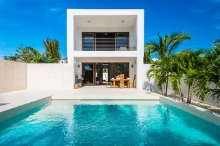 The open-plan living area looks out to an intimate courtyard with an infinity pool.