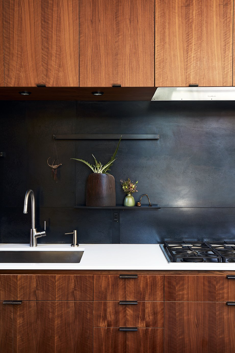The metal backsplash and drawer pulls were fabricated by 12th Avenue Iron; the cooktop is by Miele.  Photo 5 of 15 in Greener Grass