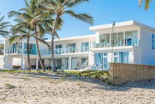 This modern beachfront home in the Dominican Republic enjoys stunning ocean views from every room.