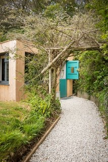 The secluded Libertine Cottage near Perranporth Beach was once an 18th-century pigsty before its owner, an ex-fashion buyer, turned it into a special hideaway that's filled with industrial furnishings and colors that pop.