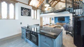 A former 19th-century Methodist chapel in the countryside near Padstow, Seraphina was transformed into an open-plan, two-level home with vaulted ceilings and stained-glass windows.