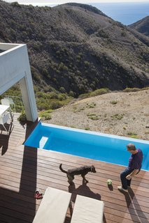 Cantilevered over the hillside is a stainless steel pool by Bradford Products.