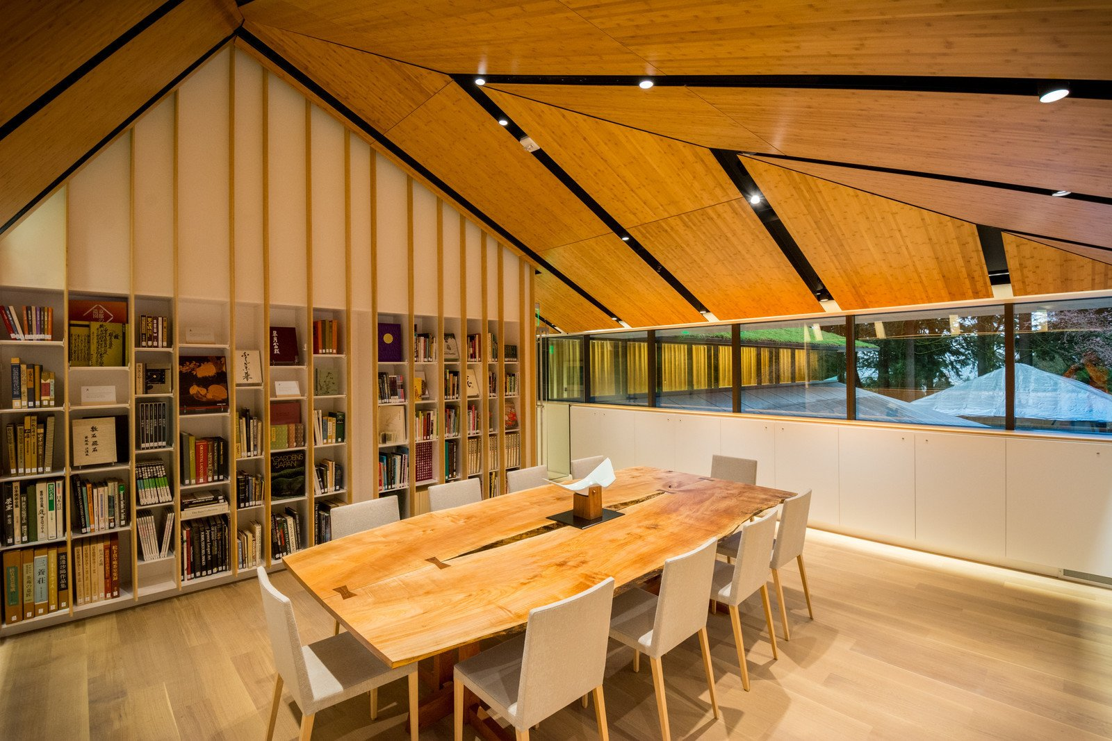 The collection of Japanese garden and cultural books is housed in the Vollum library. A custom-made George Nakashima table sits in the foreground.  Photo 3 of 8 in Take a Tour of Kengo Kuma's Expansion of the Portland Japanese Garden