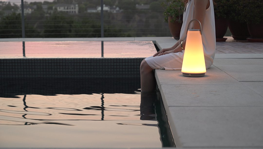 Designed for both indoors and outdoors, the portable lamp works as both a speaker and a light with bluetooth connectivity, full-range dimming control, and touch-sensitive volume control.  Photo 5 of 6 in Extend Your Time Outside With These 6 Innovative Lighting Designs For Your Outdoor Space