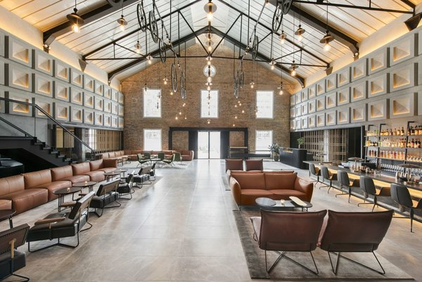 Designed by Asylum and Zarch Collaborative, the converted warehouse boasts a lobby with vaulted ceilings that puts a spotlight on the original pulley systems that were commonly found in godowns.
