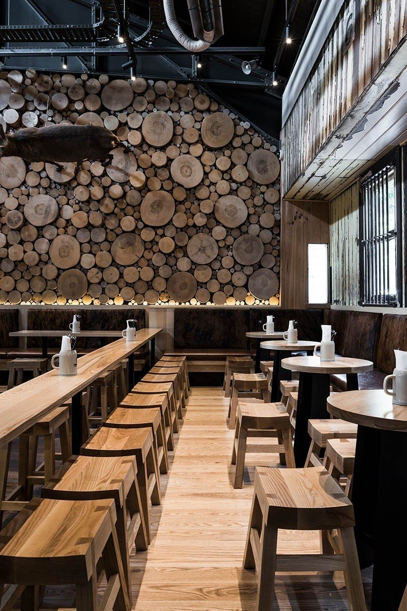 A rustic setting indeed. Between the tree trunk cross sections and mixed wood tones throughout the space, this beer house makes you feel like you are gathering in a Bavarian forest.  Photo 10 of 10 in 10 Cozy Spaces and 15 Products to Help You Get Ready For Fall