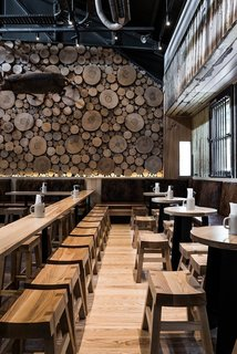 Cross sections of tree trunks line the walls of this German-style beer house in Melbourne, Australia. With various types of wood used throughout the space, the effect is multidimensional and complex, yet still warm and approachable. It's the perfect place to welcome in fall.