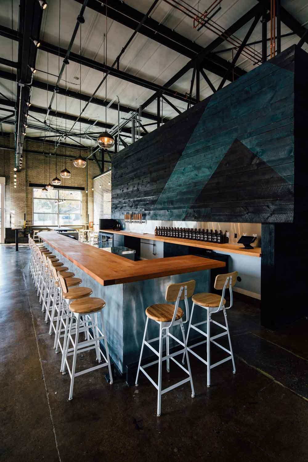 An indoor biergarten with an industrial edge, this is the perfect combination of the traditional beer hall and the modern meeting place.  Photo 8 of 12 in 10 Brewpubs That Have Tapped the Art of Modern Design