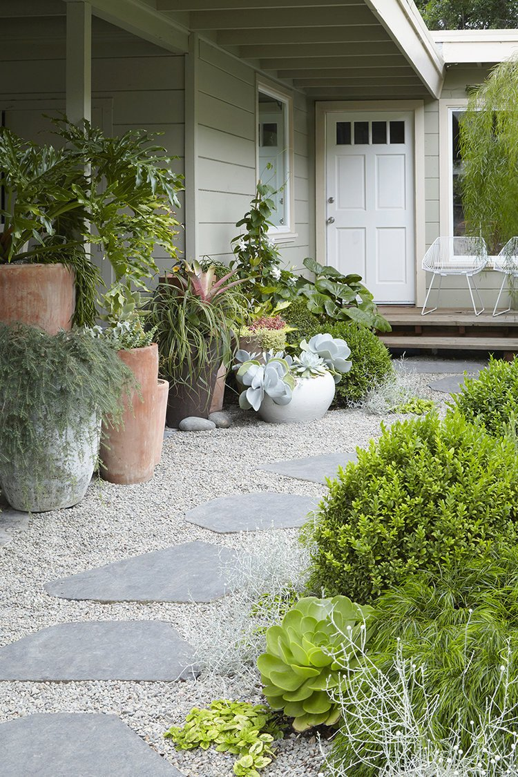 In this garden by Flora Grubb, contemporary containers and minimal furniture help to create an eclectic, modern environment.  Photo 5 of 11 in 10 Modern Gardens That Freshen Up Traditional Homes