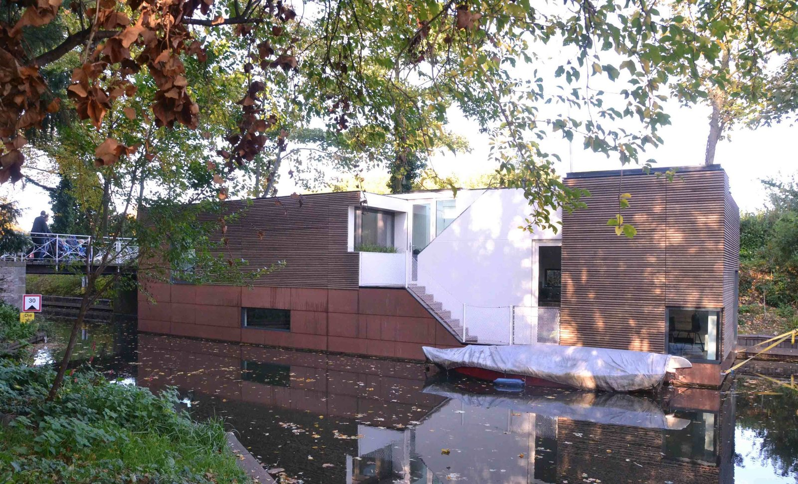 Exterior, Wood Siding Material, Flat RoofLine, and Boathouse Building Type Anchored beside a wooded parkland, this houseboat in the Netherlands was designed by BYTR Architects.  Photo 4 of 11 in 10 Modern Floating Homes That Offer an Aquatic Lifestyle