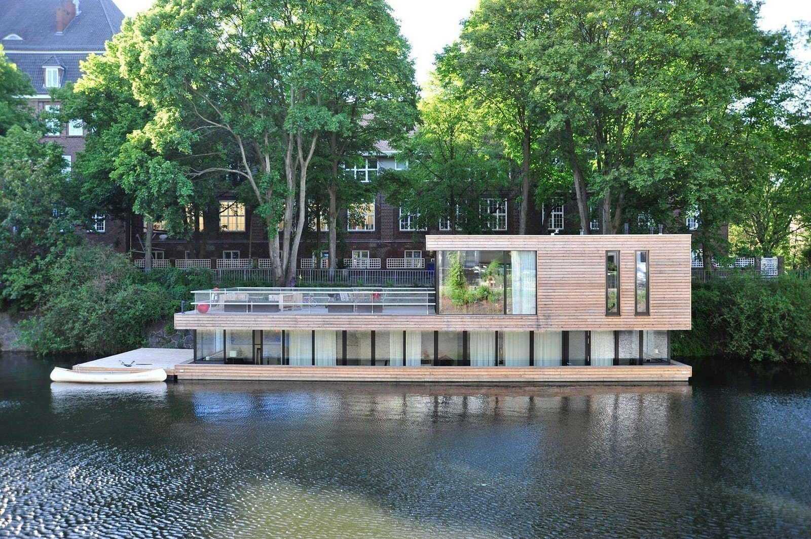 Exterior, Flat RoofLine, Boathouse Building Type, and Wood Siding Material  Photo 1 of 11 in 10 Modern Floating Homes That Offer an Aquatic Lifestyle