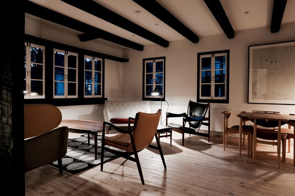 Furnished entirely with pieces by Bauhaus-era Danish designer Finn Juhl, House of Finn Juhl in the small Japanese town of Hakuba, Nagano, features a pared-down elegance that complements its alpine surroundings.