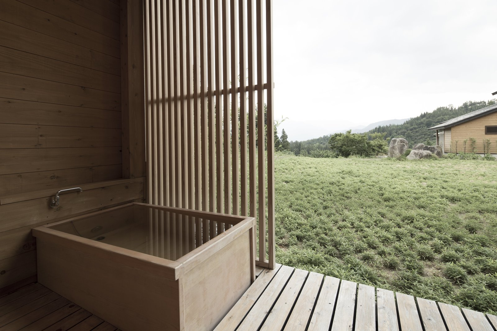 Bath Room, Medium Hardwood Floor, and Freestanding Tub Just a short two hour high-speed train ride from Tokyo will take you to Minami-Uonuma, in the region of Niigata.  Photo 2 of 13 in Hide Out in One of These Asian Retreats That Are Immersed in Nature