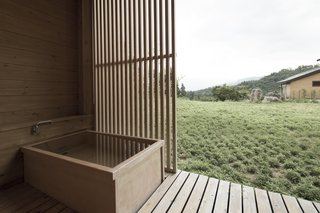 A two-hour ride on a high-speed train from Tokyo will take you to Satoyama Jujo in Minami-Uonuma. An open-air bathtub allows you to literally immerse yourself in nature.