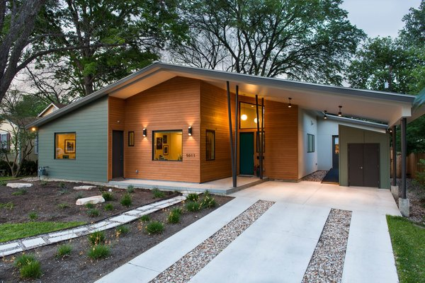 The home pays tribute to the neighborhood's midcentury roots in style and scale. The Hemlock Fir siding is warm and welcoming. There are three entrances—the main entrance, a separate office entrance, and one that goes directly into the laundry/mud room.