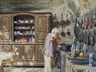 Dwell Magazine Is a Medal Finalist For Two SPD Photography Awards - Photo 1 of 6 - In the limestone kitchen embedded in the hillside, Lolo keeps only proven essentials—skillets that have been seasoned countless times and furniture that has been passed down for generations.