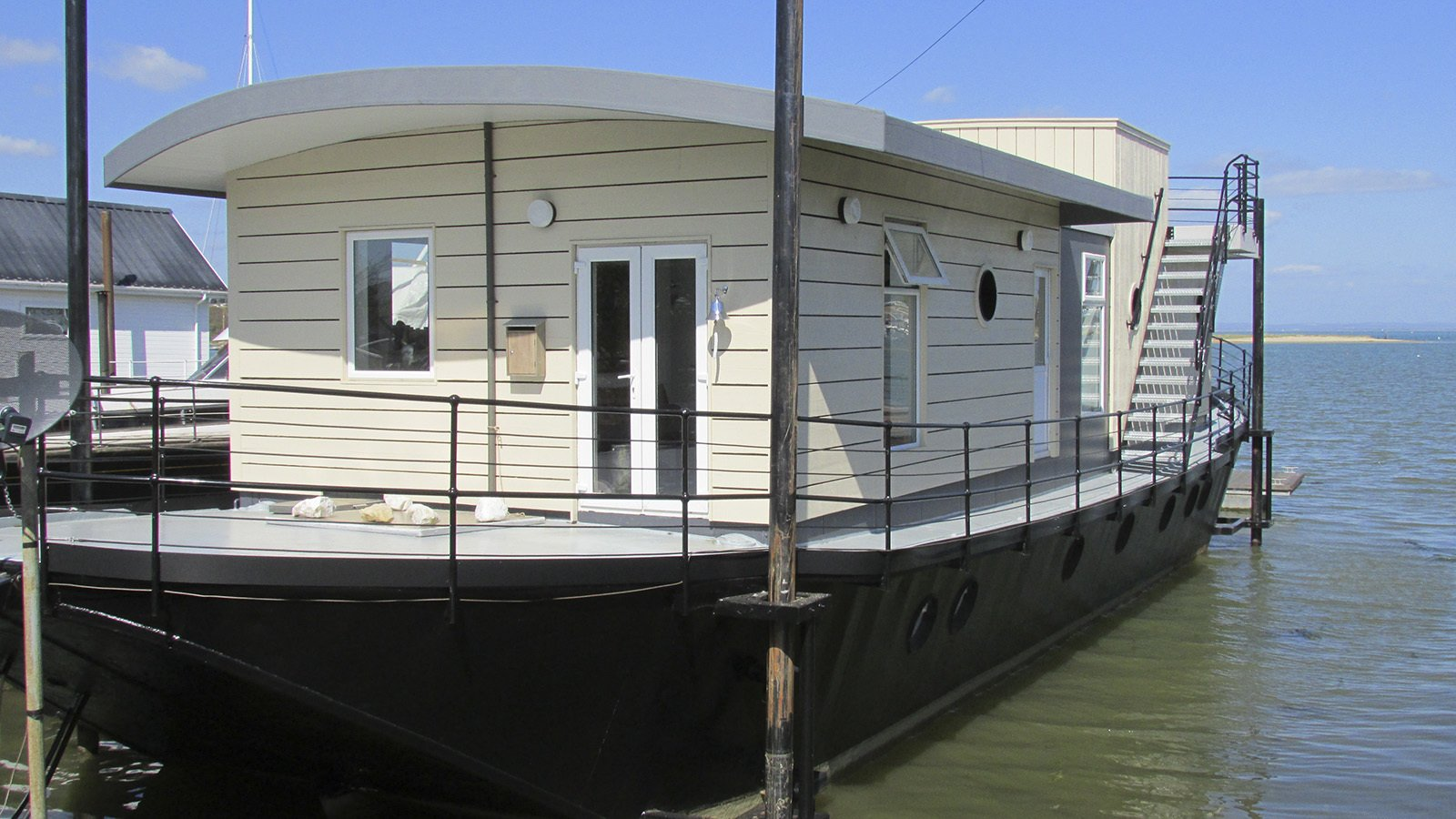 The Harbour Houseboat, which offers stunning views across Bembridge Harbour in Isle Of Wight has a commodious open-plan living lounge and kitchen, and warmly furnished rooms with plush Loaf beds.  Photo 8 of 11 in Make Yourself at Home in One of These Small Spaces on Boats That You Can Rent