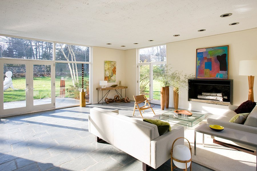 The understated facade of the Alice Ball House conceals 12-foot ceilings. It's one of five significant houses designed by Philip Johnson in New Canaan, CT.  Photo 6 of 8 in There's No Shortage of Glass in These 7 Homes Designed by Philip Johnson