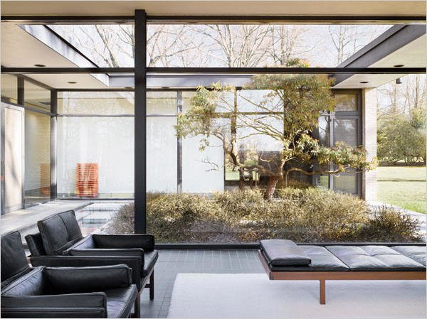 Located across the street from Johnson's own Glass House, the Hodgson House was built for Richard and Geraldine Hodgson in 1951. The U-shape International Style home features a garden court.  Photo 5 of 8 in There's No Shortage of Glass in These 7 Homes Designed by Philip Johnson