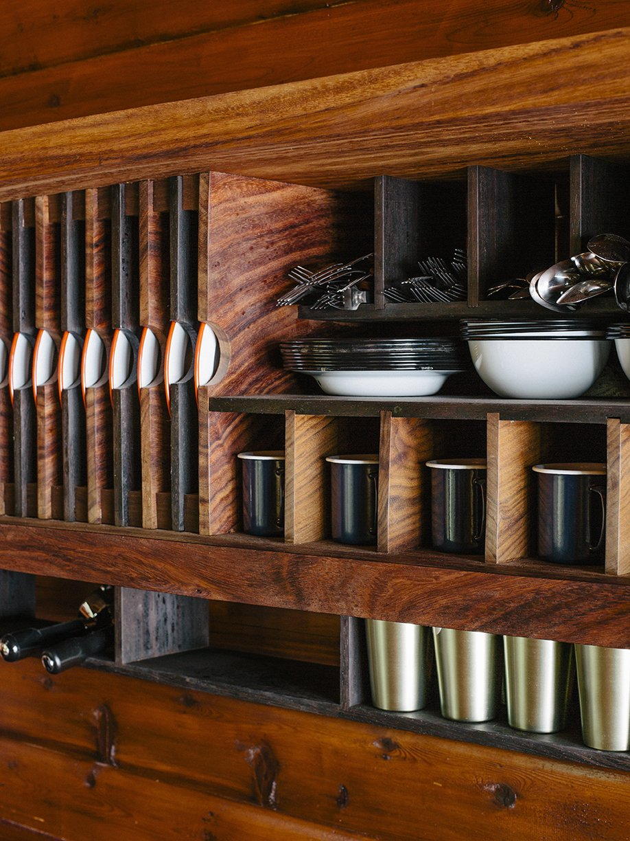 Storage Room and Shelves Storage Type The kitchen was designed like a ship, with built-in storage created by Conrad Contracting.  Photo 6 of 13 in An Eclectic Pacific Northwest Cottage