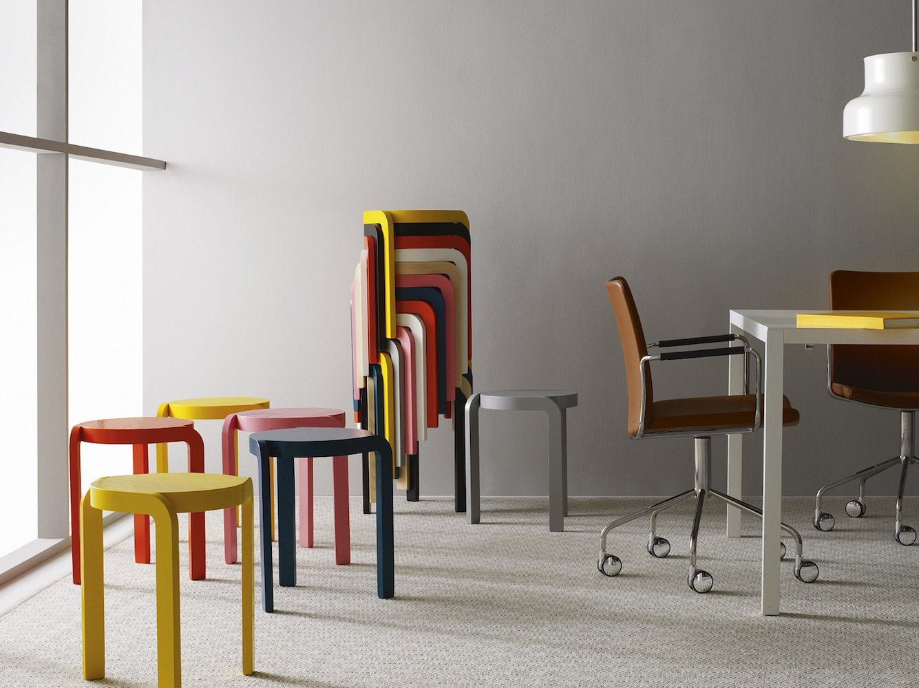 Office, Chair, Carpet Floor, and Desk There is no need to stow-away spare seating that is this beautiful. Perfect for small space entertaining, these lightweight Spin Stools can be stacked up and stored in a rainbow spiral—the epitome of minimalist Scandinavian design.  Photo 3 of 12 in 10 Functional Pieces For Small Space Living