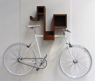 10 Functional Pieces For Small Space Living - Photo 1 of 11 - A bicycle rack for the design-conscious cyclist, the Pedal Pod looks good with or without your bicycle. The multifunctional piece offers ample cubby space to stash odds and ends, and frees up floor space while storing your bike.