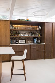 The kitchen and bar millwork is ApplePly with a walnut veneer.