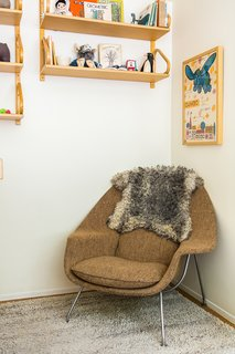 In Search of Alvin Lustig - Photo 8 of 13 - In daughter Elliot's room, a vintage Womb chair by Eero Saarinen is situated below Alvar Aalto 112 sheIn daughter Elliot's room, a vintage Womb chair by Eero Saarinen is situated below Alvar Aalto 112 shelving scored on eBay.