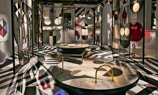 "Spanish artist/designer Jaime Hayon devised the collages of quartz seen Caesarstone's eye-popping pavilion at Palazzo Serbelloni, entitled ""Stone Age Folk."""