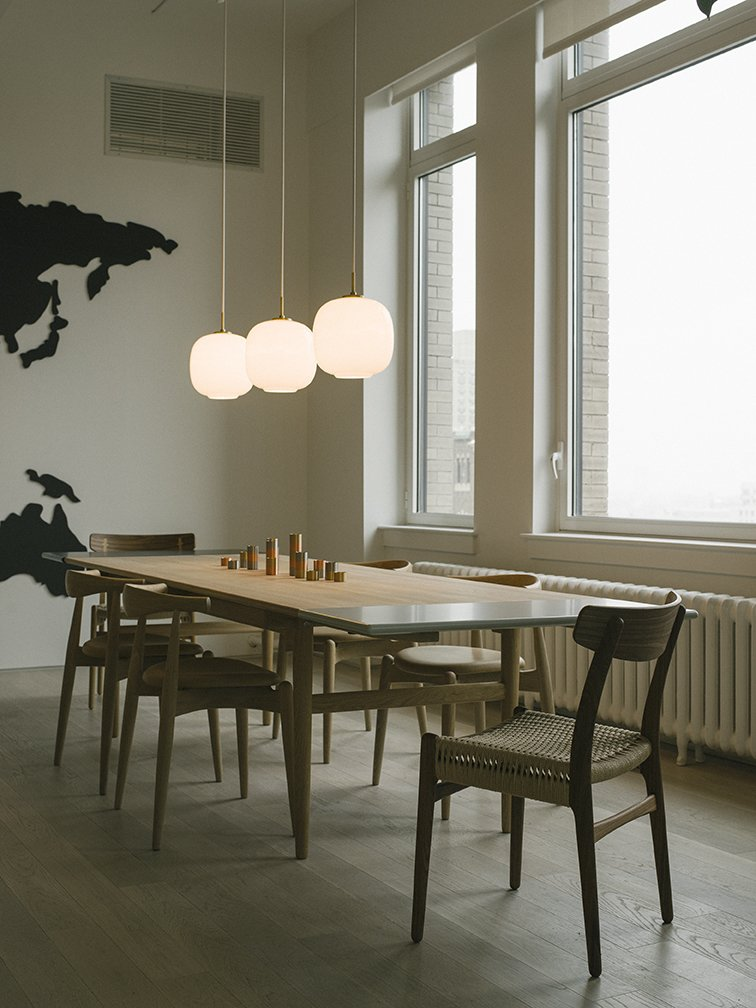 The finished chairs are made to the exact specifications of Wegner's 1949 design. The only difference  is that the original was manufactured in teak, while the new versions are available in more sustainable oak or American walnut.  Here, they appear at  the heads of a Wegner CH327 dining table.  Photo 6 of 12 in Warp Speed