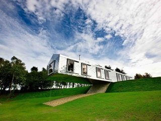 Take a Modern British Holiday in a Gleaming Cantilevered Barn