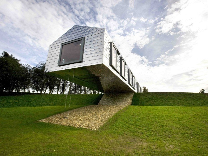 Outdoor, Slope, Grass, and Trees  Photo 3 of 11 in Take a Modern British Holiday in a Gleaming Cantilevered Barn