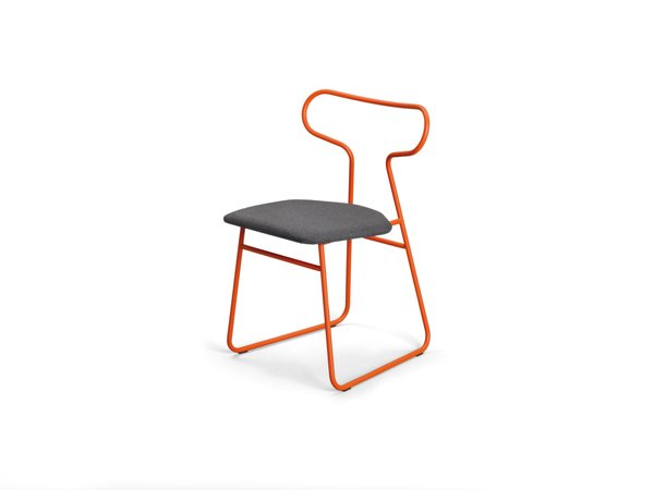 Loop chair   Rodet, which has shaped tubular steel for nearly 40 years, likens the powder-coated lines of Fred Rieffel's chair to the curves of a race track.   rodet-home.net  Photo 11 of 13 in Color Unleashed