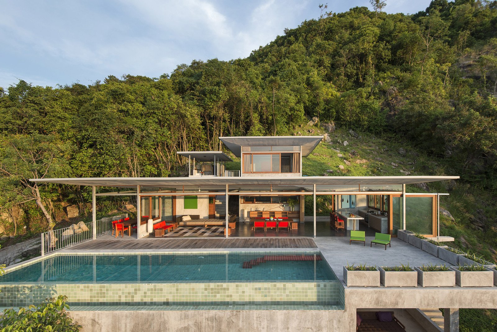 Outdoor, Grass, Infinity, Slope, Swimming, Trees, Raised Planters, Back Yard, Concrete, and Metal  Outdoor Metal Swimming Photos from Take a Trip to This Photographer-Designed Concrete Home in Thailand