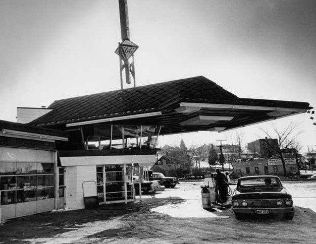 The building features a cantilevered copper canopy and is primarily made of concrete, glass, and steel. There's a glass observation lounge on the second floor for community interaction. Cypress, one of Wright's favorite materials, is used throughout the interior. Photo circa 1963.  Photo 2 of 3 in Frank Lloyd Wright's Little Known Gas Station For the Future