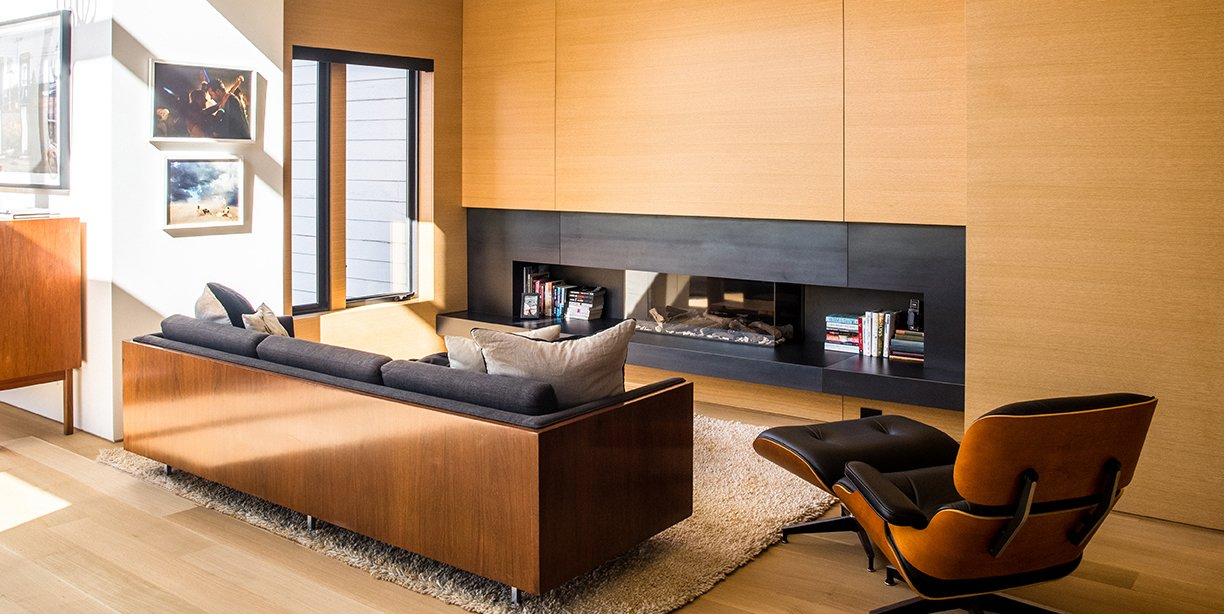Living Room, Ribbon Fireplace, Ottomans, Chair, Gas Burning Fireplace, Light Hardwood Floor, and Sofa  Photo 1 of 15 in Domino Effect: How a Bedroom Refresh Jump-Started a Whole-House Remodel For a Tech Exec